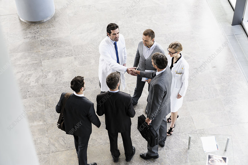 Business people and doctors greeting