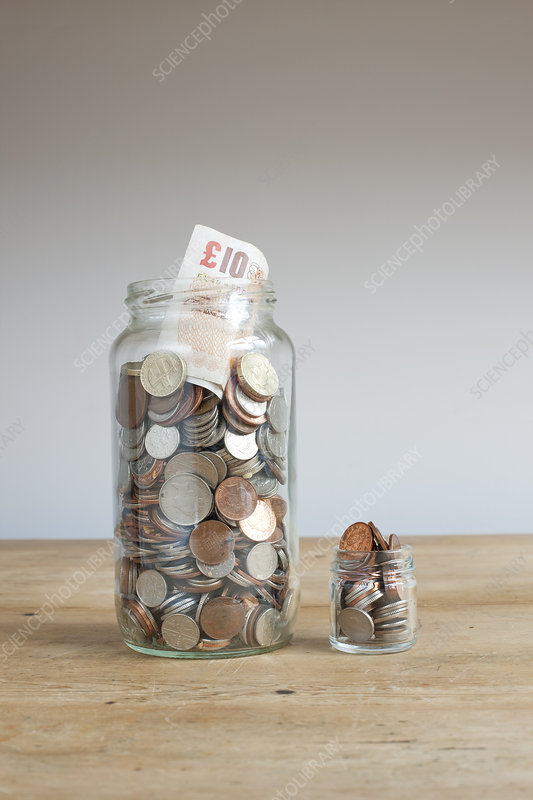 Large and small savings jars on desk