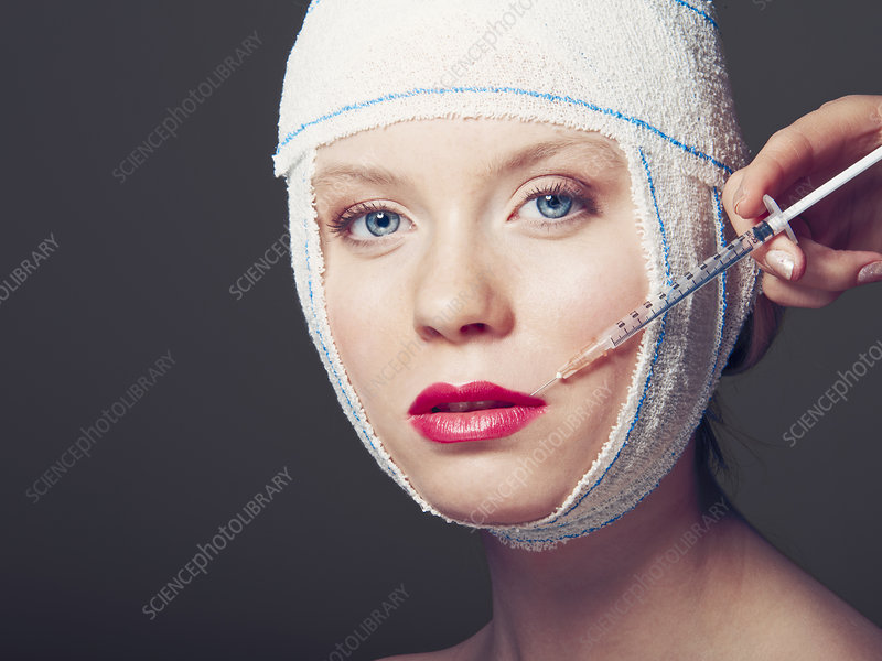 Woman in bandages having injection