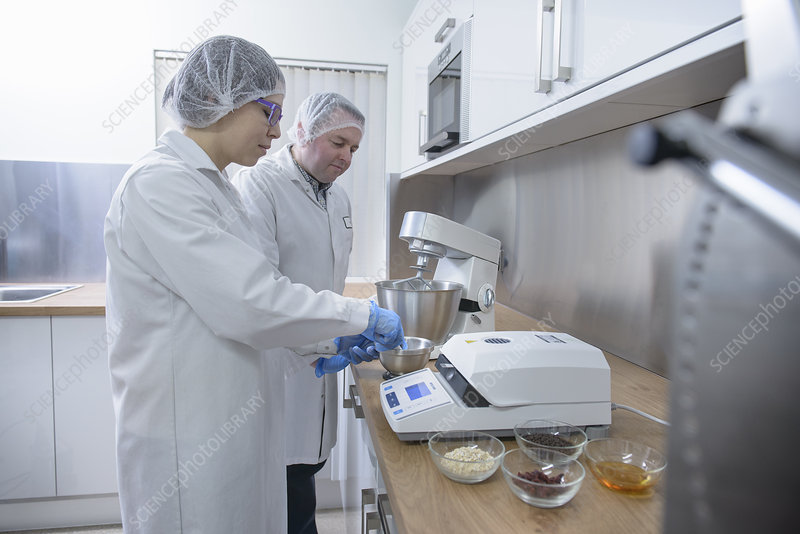 Workers testing in biscuit factory