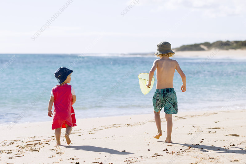 Children playing in sand on beach