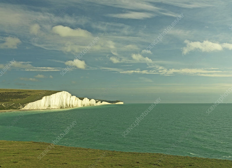 White cliffs over ocean on beach