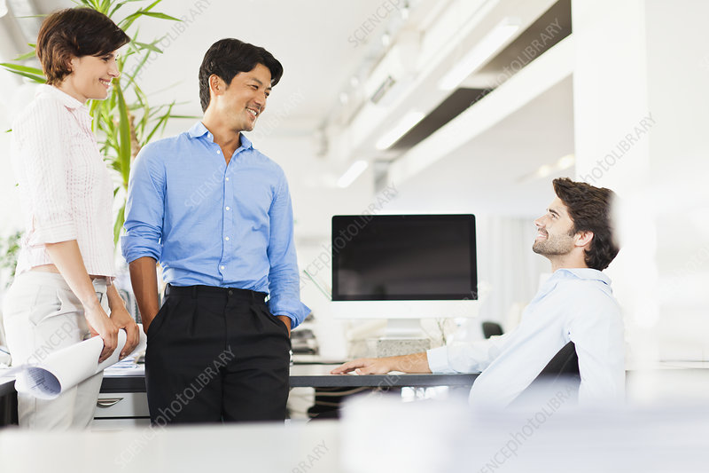 Business people talking at desk