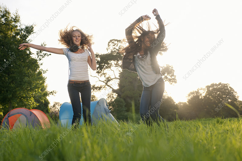 Teenage girls dancing in field