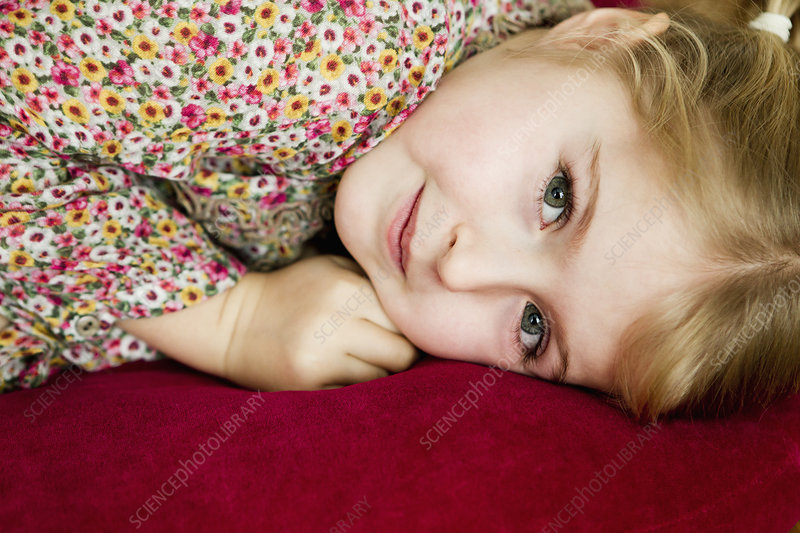 Smiling girl laying on pillow