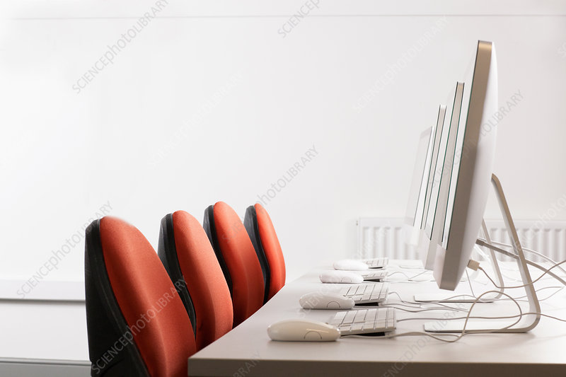 Computers and chairs at desk