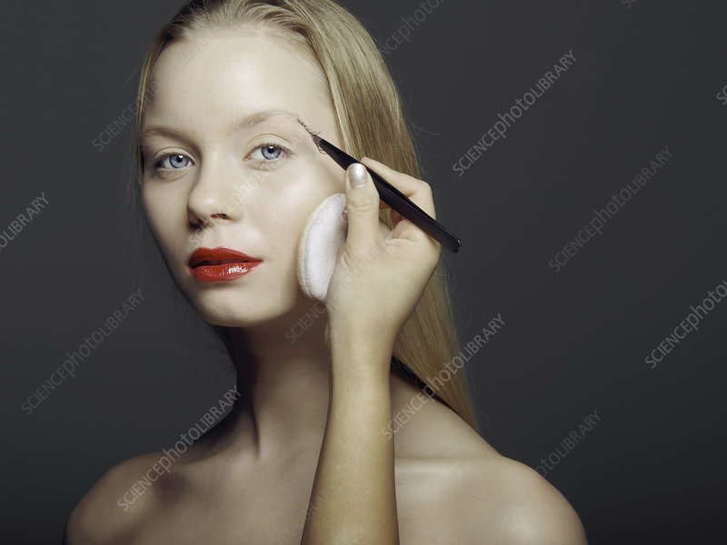 Woman having makeup applied
