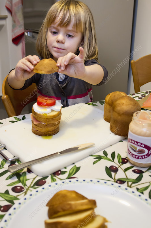 Girl making layer cake