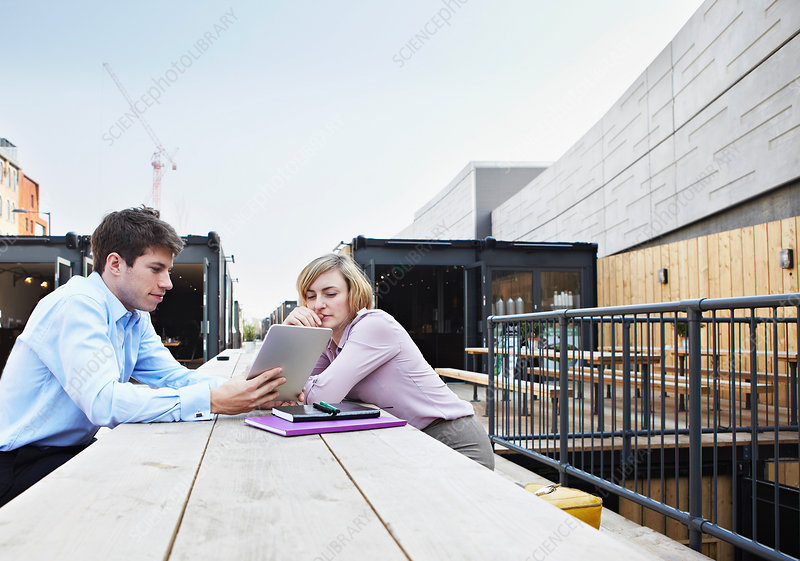 People using tablet computers outdoors