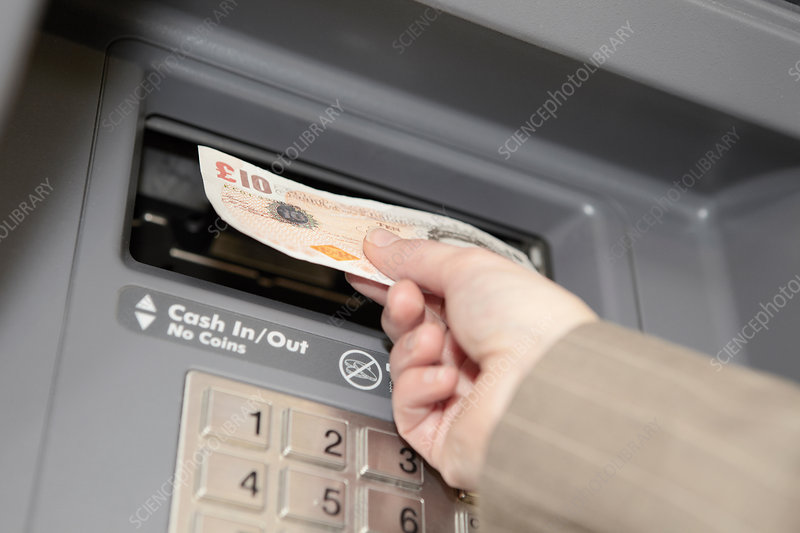Woman withdrawing cash from cashpoint