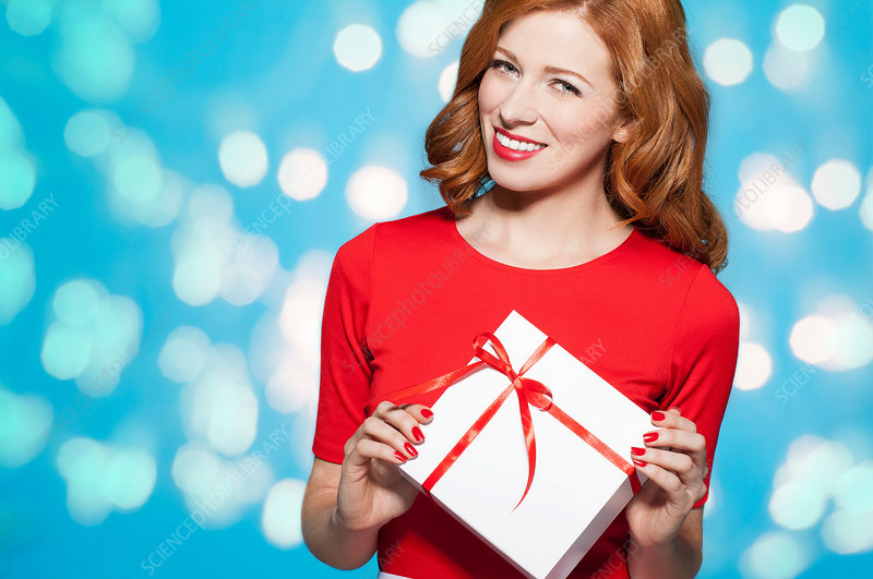 Woman holding white gift box with red bow