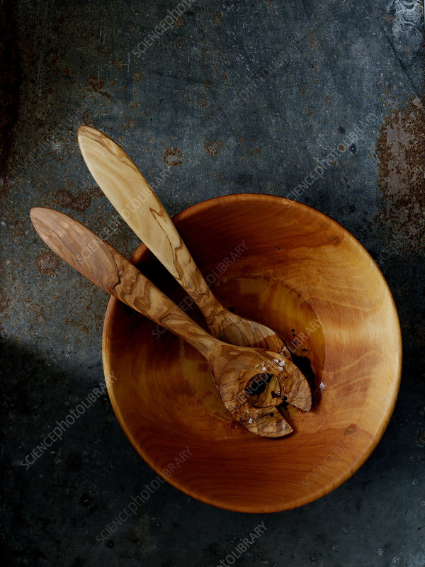 Wooden salad bowl and serving spoons