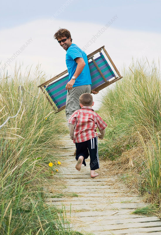 Father and boy heading for the beach