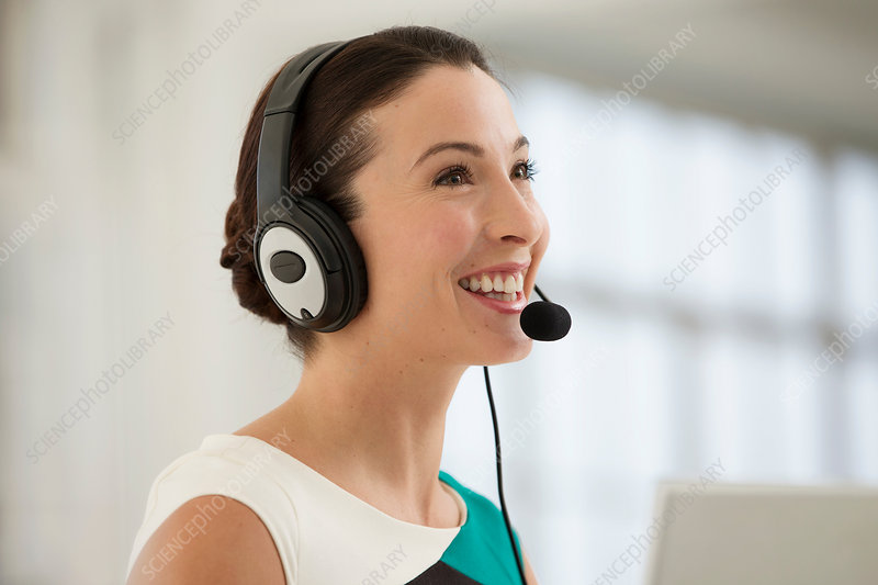 Female telephonist wearing headset