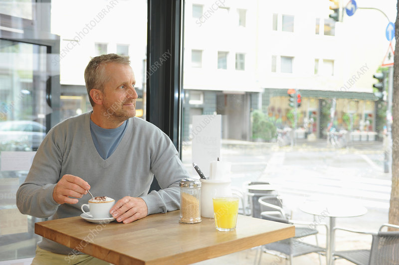 Mature man sitting in coffee shop