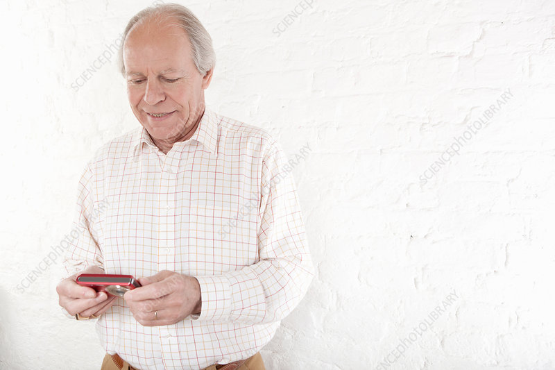 Senior man holding digital camera