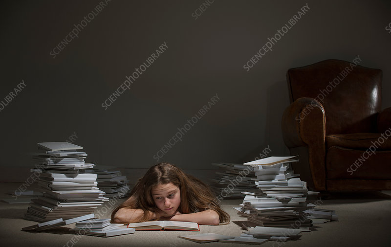 Girl lying on front reading book