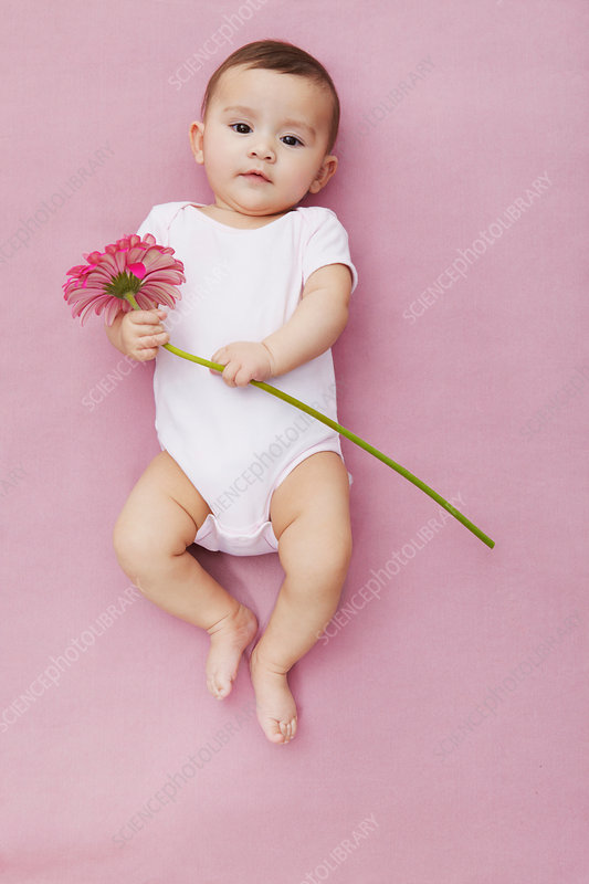 Baby girl with gerbera flowers