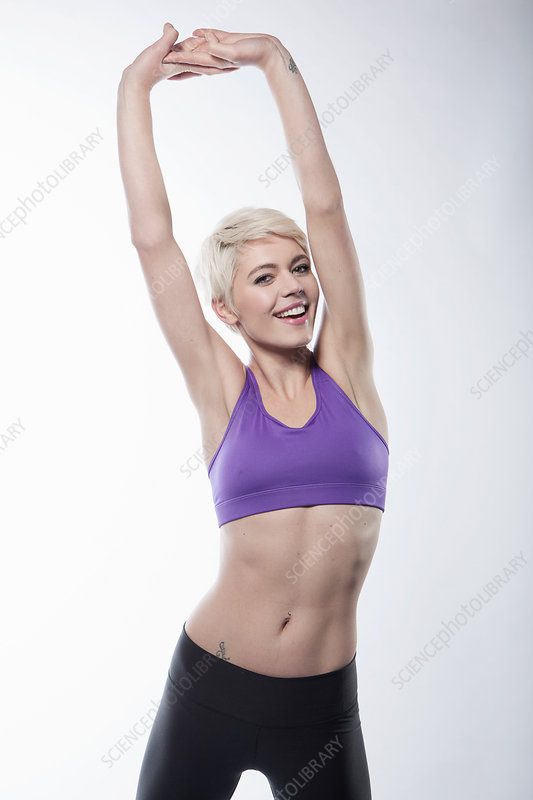 Woman exercising with arms up