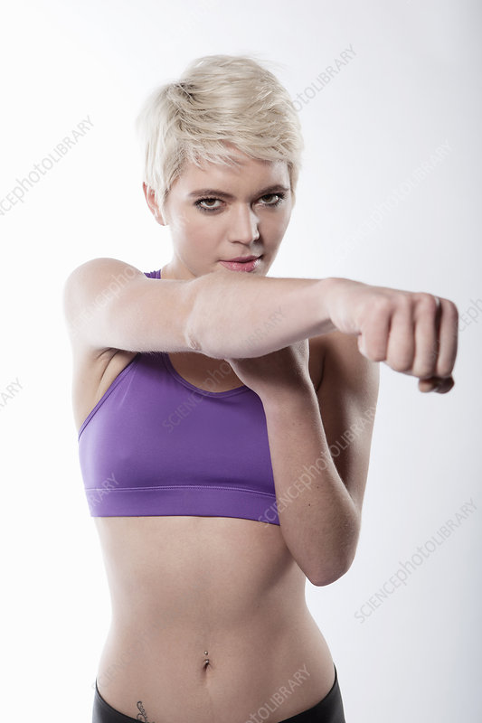 Woman exercising with arm out