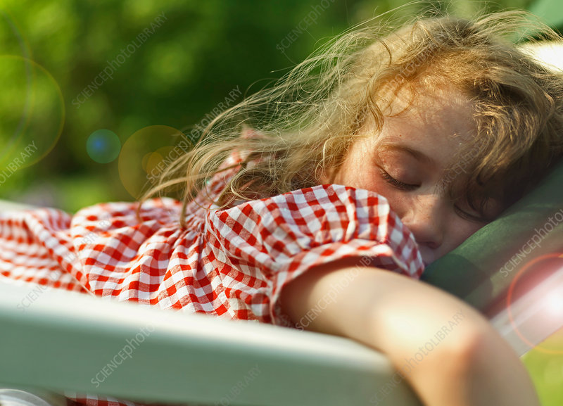 Girl sleeping outdoors