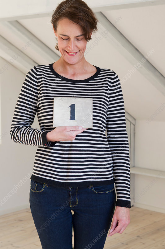 Woman holding paper with number 1