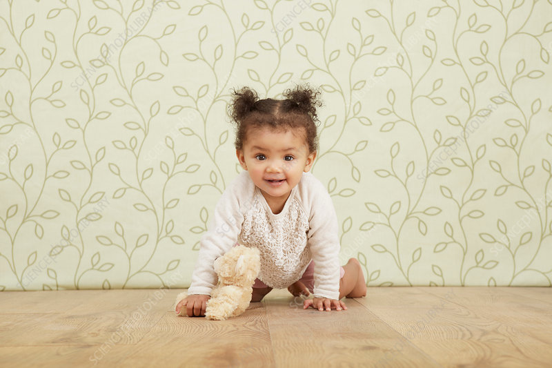 Portrait of baby girl taking crawling