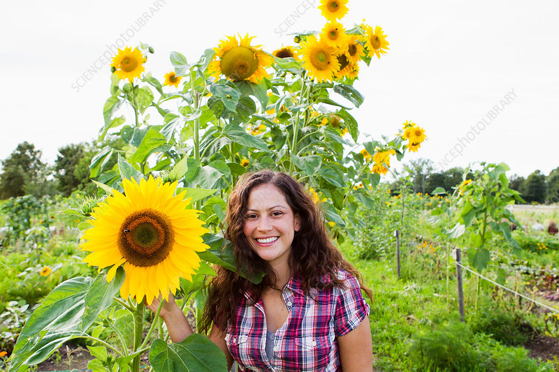 Woman with yellow sunflowers