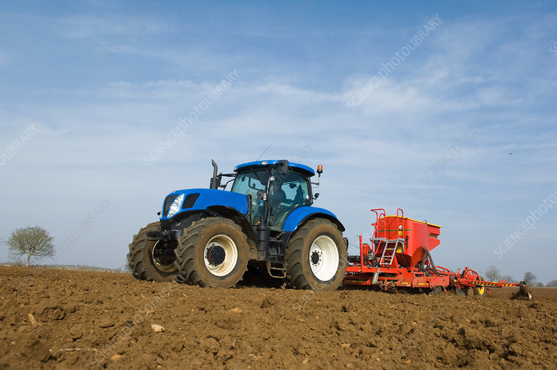 Tractor pulling equipment to plant seeds