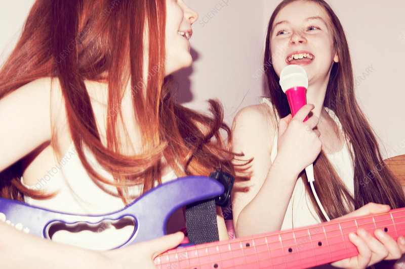 Two girls playing guitar and singing