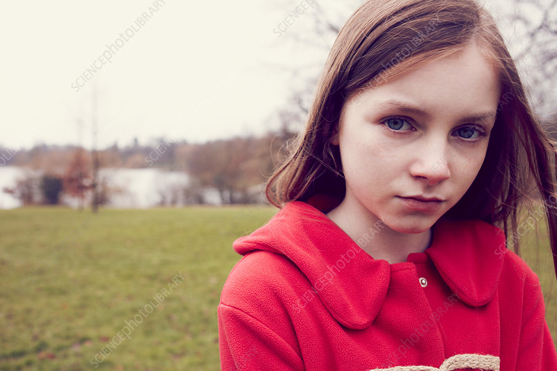 Portrait of pensive girl outdoors