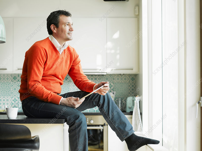 Mature man using tablet