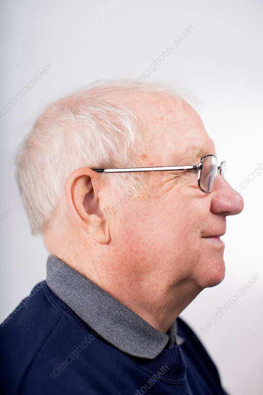 Profile of senior man wearing glasses