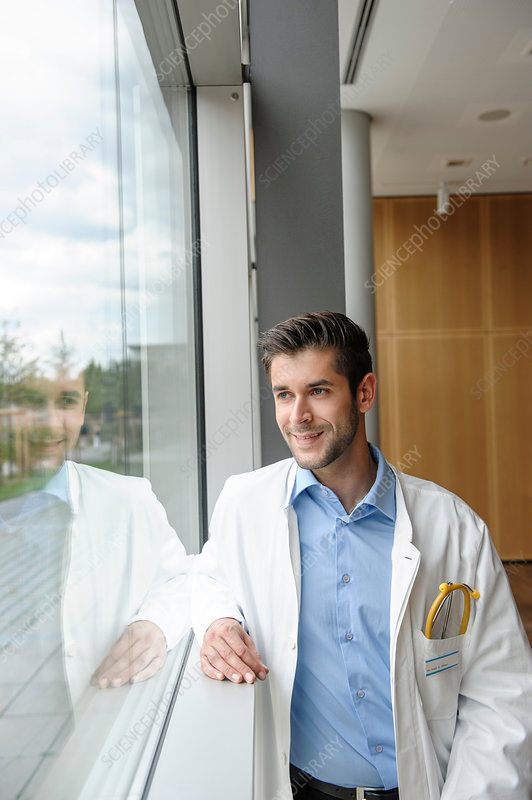 Portrait of young male doctor smiling