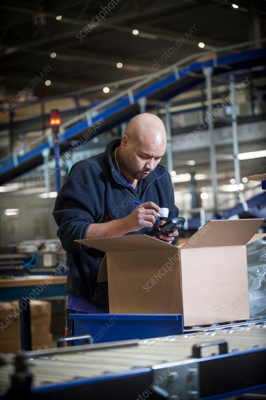 Warehouse worker using barcode scanner