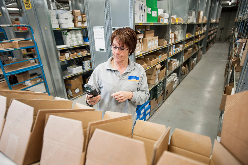 Female warehouse worker checking orders