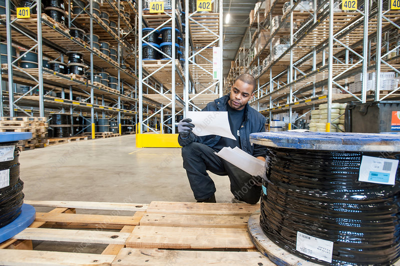 Warehouse worker checking pallet order