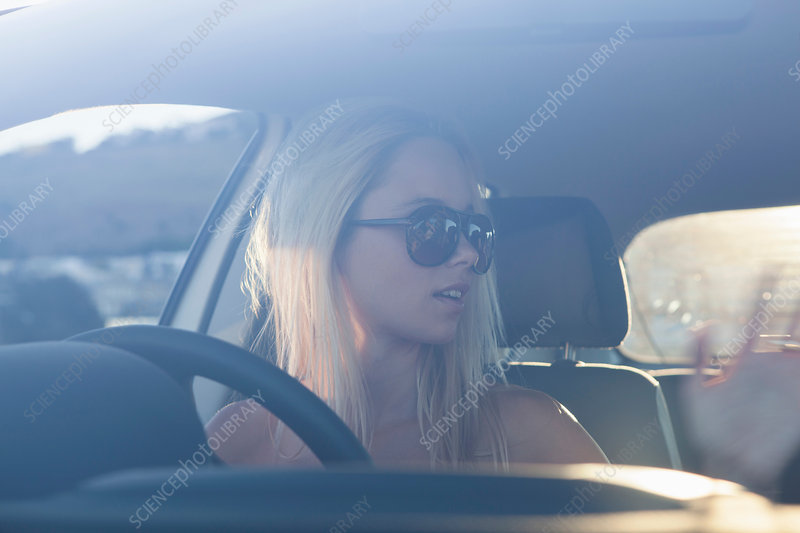 Young women in car wearing sunglasses