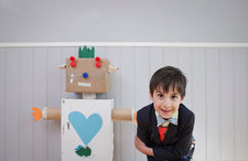 Boy with homemade toy robot