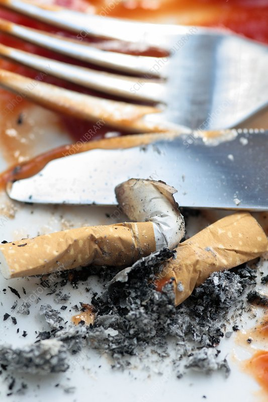 Cigarettes stubbed out on plate