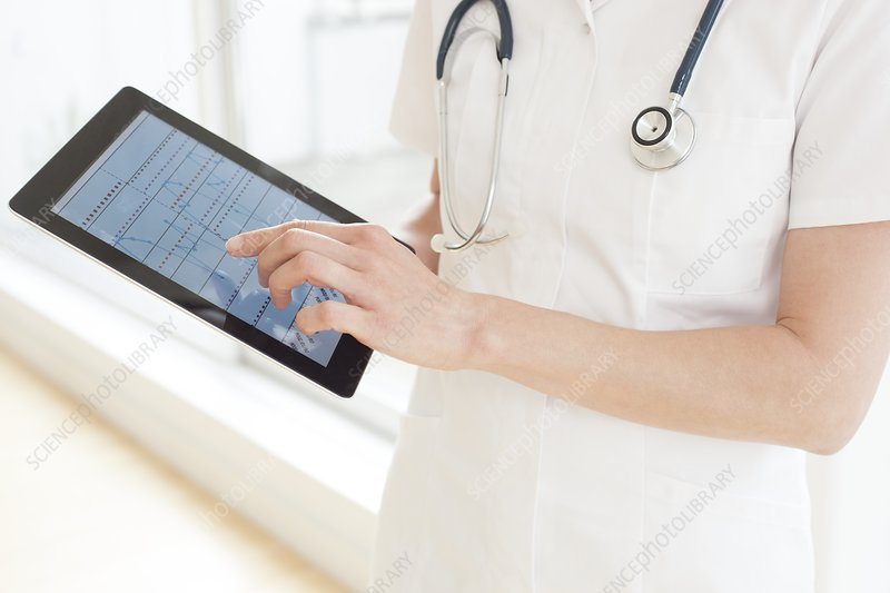 Nurse using a tablet computer