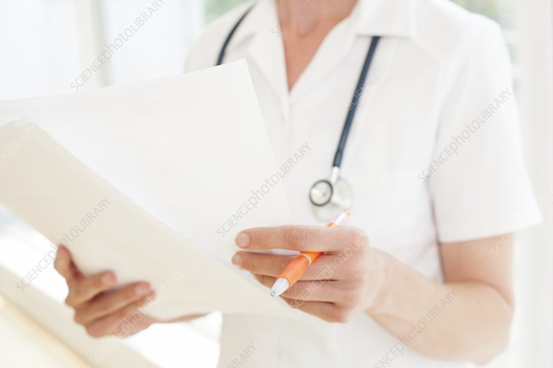 Nurse with paperwork