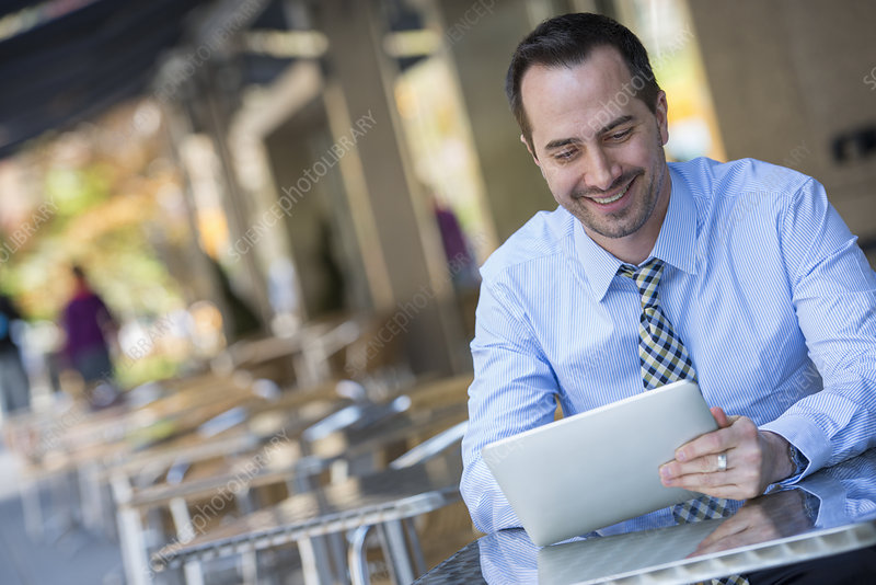 Man in cafe using a digital tablet