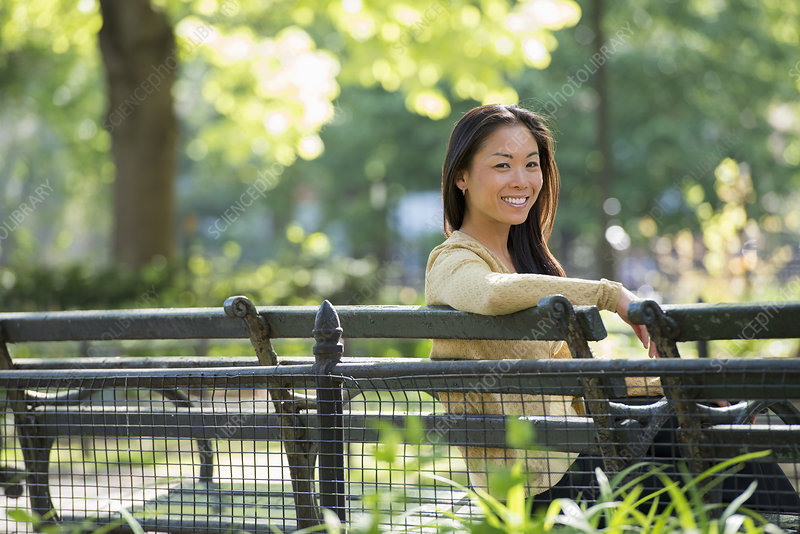 Woman on city park bench