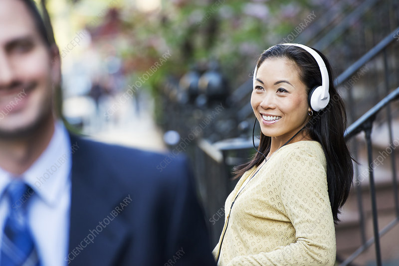 Woman listening to music in the street