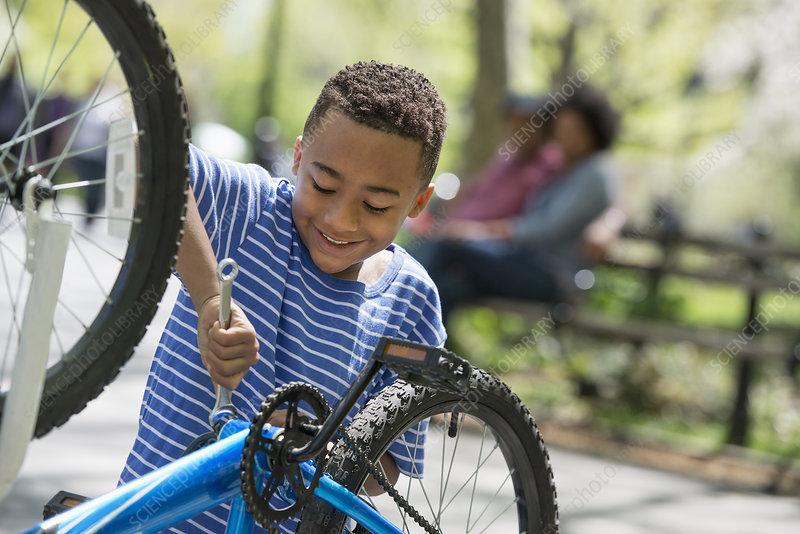 Man and boy repairing bicycle