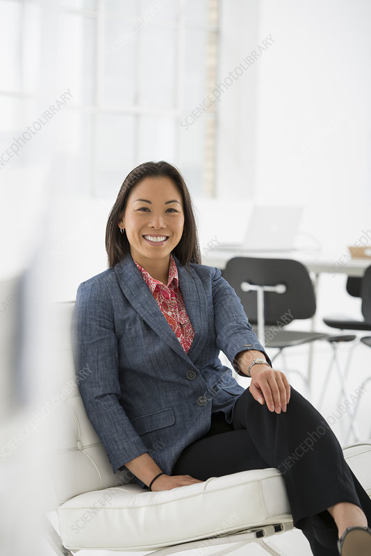 Woman relaxing in comfortable chair