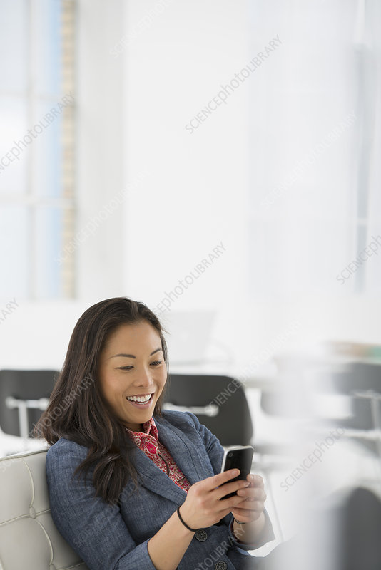 Businesswoman checking her smart phone
