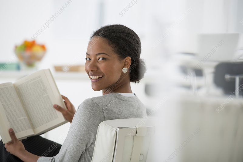 Businesswoman seated with Book