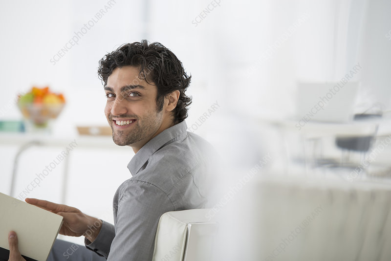 Businessman holding Book relaxing